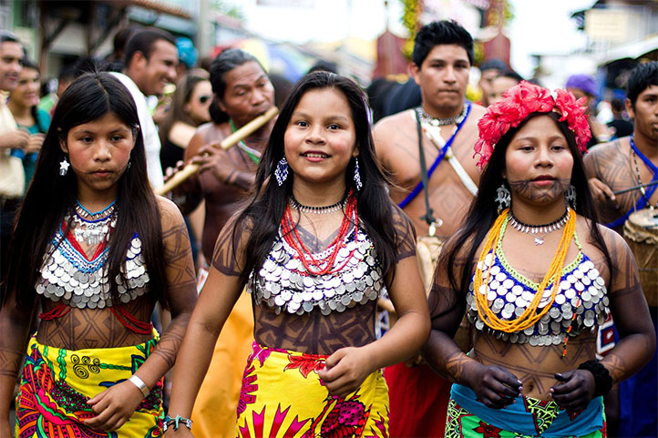 Embera girls walking with their typical clothing