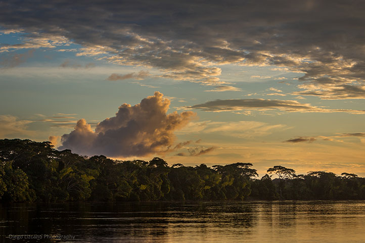 Sunset, clouds, trees and river in San Vicente del Caguán
